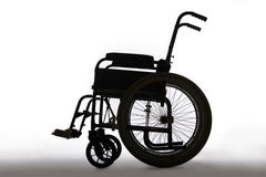 Silhouette Of Empty Wheelchair In Studio Stock Photos