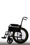 Silhouette Of Empty Wheelchair In Studio Stock Image
