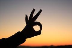 Silhouette en bon état de signe de main Photos libres de droits