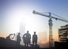 Silhouette engineer  in a building site over Blurred constructio Stock Image