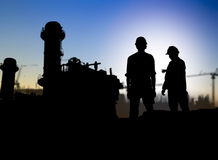Silhouette engineer looking construction worker in a building si Royalty Free Stock Photography