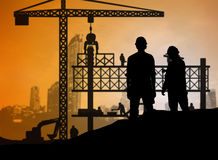 Silhouette engineer looking construction worker in a building si Royalty Free Stock Image