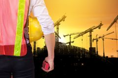Silhouette engineer standing orders for construction crews to wo royalty free stock photo