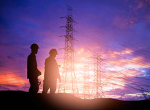 Silhouette  engineer working  in a building site over Blurred co Stock Images