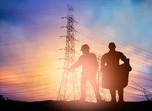 Silhouette  engineer working  in a building site over Blurred co Royalty Free Stock Photo