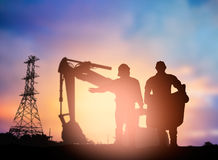 Silhouette  engineer working  in a building site over Blurred co Royalty Free Stock Images
