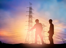 Silhouette  engineer working  in a building site over Blurred co Stock Image