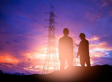Silhouette  engineer working  in a building site over Blurred co Stock Photo