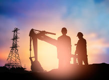 Silhouette  engineer working  in a building site over Blurred co Royalty Free Stock Photos