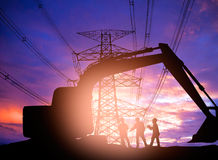 Silhouette  engineer working  in a building site over Blurred co Stock Photos