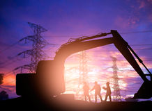 Silhouette  engineer working  in a building site over Blurred co Royalty Free Stock Photography