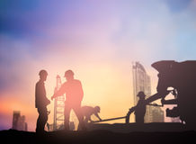 Silhouette engineer working  in a building site over Blurred con Royalty Free Stock Image