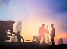 Silhouette engineer working  in a building site over Blurred con Stock Image