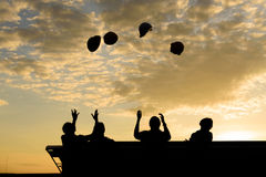 Silhouette of Engineers throwing up hat for celebrate after proj Royalty Free Stock Images