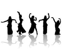 Silhouette est de danseuses de femme Photographie stock libre de droits