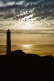 Silhouette et mouette de phare Photos stock