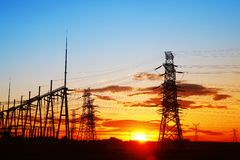Pylon. The silhouette of the evening electricity transmission pylon royalty free stock image
