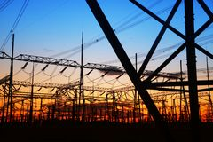 Pylon. The silhouette of the evening electricity transmission pylon stock photos