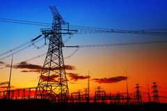Pylon. The silhouette of the evening electricity transmission pylon stock images