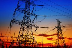 Pylon. The silhouette of the evening electricity transmission pylon stock photography