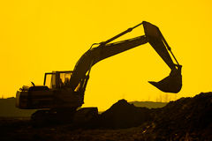 Silhouette excavator Stock Photography