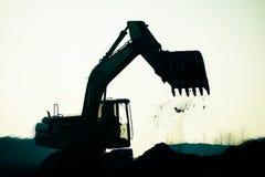 Silhouette excavator Stock Images