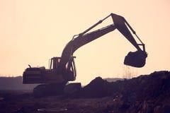 Silhouette excavator Royalty Free Stock Photos