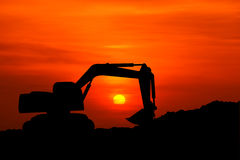 Silhouette of excavator machine Stock Images