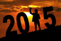 Silhouette of excited man forming number 2015 Stock Photo