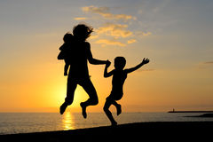 Silhouette of exciting woman with children having Royalty Free Stock Photos