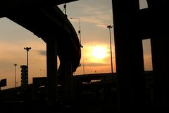 Silhouette of the expressway. View From Under the expressway. Looking The Sunset Stock Image