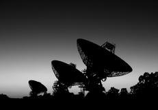 silhouette för 3 satelliter Arkivfoton