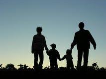 silhouette för familj fyra Royaltyfria Bilder