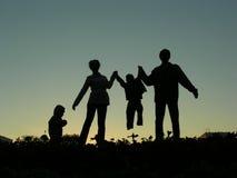 silhouette för familj fyra Royaltyfri Fotografi