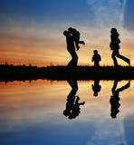 silhouette för familj fyra Royaltyfri Bild