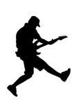 silhouette för gitarrbanhoppningspelare Arkivbilder