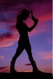 Silhouette för kvinnastandtryckspruta Arkivbild