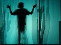 silhouette för pojke s Arkivbild