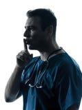 Silhouette för stående för doktorsmankirurg hyssja arkivfoton