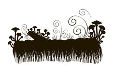 Silhouette of a fabulous mushrooms on a log in the grass Stock Photo