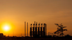 Silhouette of factory at sunset Royalty Free Stock Photography