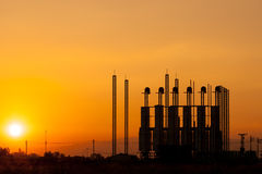 Silhouette of factory at sunset Stock Photography