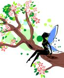 Silhouette of fairy. Sitting on branch of blossoming tree Royalty Free Stock Photography