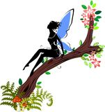 Silhouette of fairy. Sitting on branch of blossoming tree Royalty Free Stock Photo