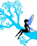 Silhouette of fairy. Sitting on branch of tree Royalty Free Stock Images