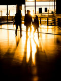 Silhouette family in airport preparing for departure Stock Photos