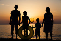 Silhouette of family at the beach Stock Photo