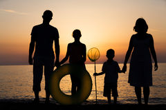 Silhouette of family at the beach Stock Photography