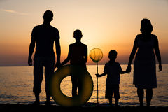 Silhouette of family at the beach Stock Photos