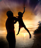 Silhouette family of child hold on father hand stock images